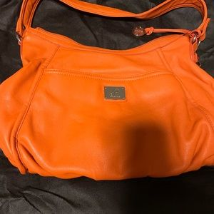 Orange hobo style purse by Grace Adele